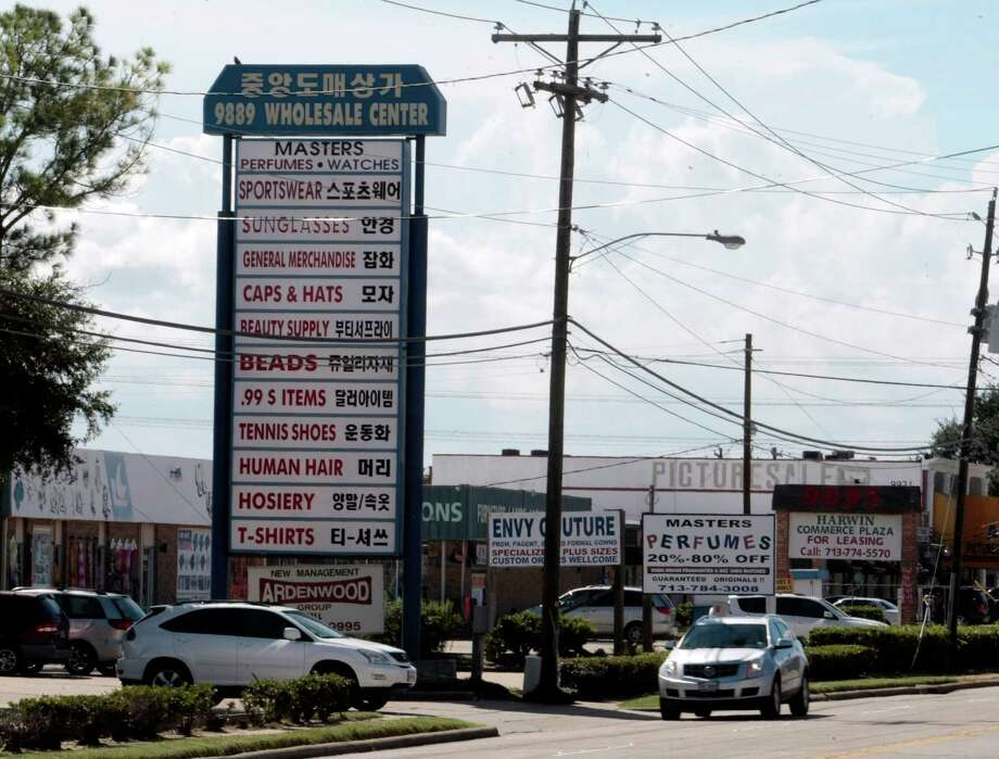 A variety of signs for shops on Harwin Drive, Tuesday October 1, 2013.The Hucksters agency is focused on bring more attention to there clients on Harwin Drive shopping district in Houston, Texas. Photo: Billy Smith II, Chronicle / © 2013 Houston Chronicle
