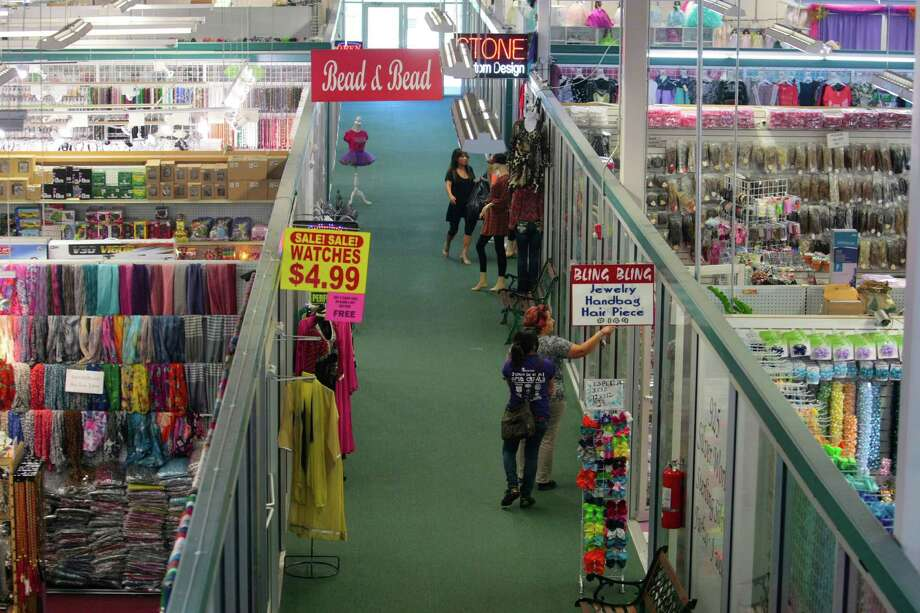 Shoppers walk the aisles at Harwin Central Mart Tuesday October 1, 2013.The Hucksters agency is focused on bring more attention to there clients on Harwin Drive shopping district in Houston, Texas. Photo: Billy Smith II, Chronicle / © 2013 Houston Chronicle