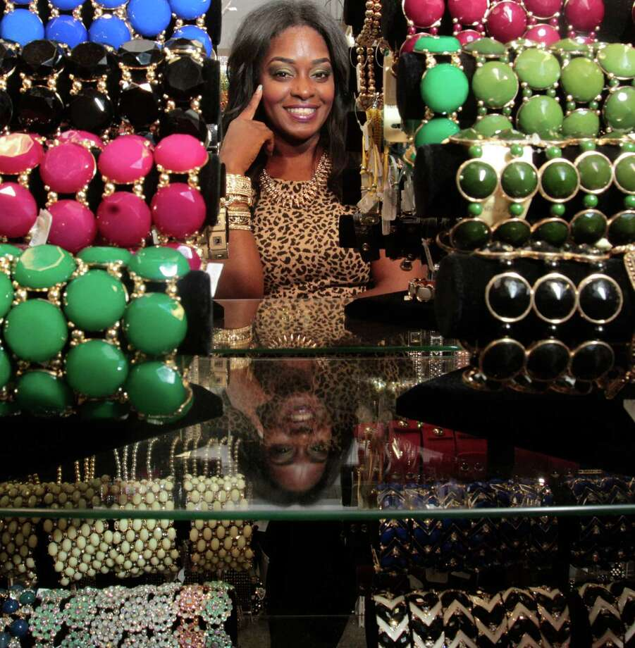 Mocca Couture of The Hucksters agency smiles at Bella Jewelry in Harwin Central Mart Tuesday October 1, 2013. Mocca Couture reaches out to the shop owners to ask if they'd like to be part of the online marketing campaign for the Harwin shopping district.The Hucksters agency is focused on bring more attention to there clients on Harwin Drive in Houston, Texas.s Photo: Billy Smith II, Chronicle / © 2013 Houston Chronicle