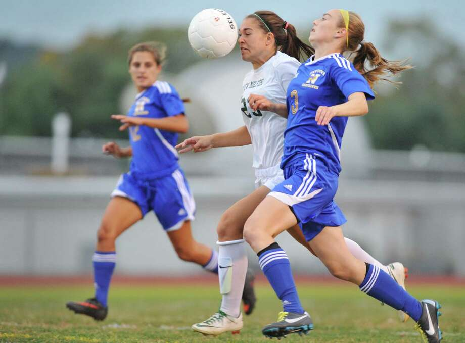 New Milford's Breanne Rehaag (23) races Newtown's Sarah Lynch (3) for the ball in New Milford girls soccer's 1-0 win over Newtown at New Milford High School in New Milford, Conn. on Thursday, Oct. 3, 2013. Photo: Tyler Sizemore / The News-Times