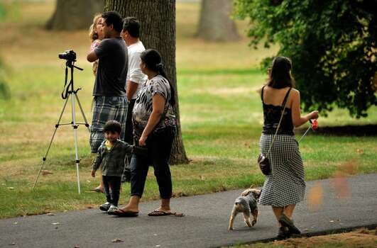 Residents and neighbors watch as law enforcement officials descend Woodside Green Condominiums on Summer Street in Stamford, Conn. as part of the investigation into the shooting in Washington, DC earlier today, Thursday, Oct. 3, 2013. Photo: Jason Rearick / Stamford Advocate