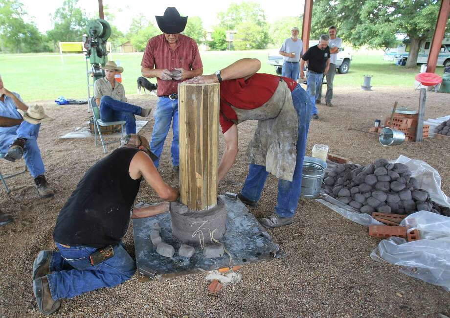 "Bill Malagarie, from Broussard, LA, left, and internationally acclaimed Virginia blacksmith/iron smelter Lee Sauder, right, begin building a ""bloom iron"" furnace,  which will produce iron made just like that from hundreds of years ago, in Oldenburg, which is near La Grange, Wednesday,Oct. 2, 2013, in Oldenburg. Photo: Karen Warren, Houston Chronicle / © 2013 Houston Chronicle"