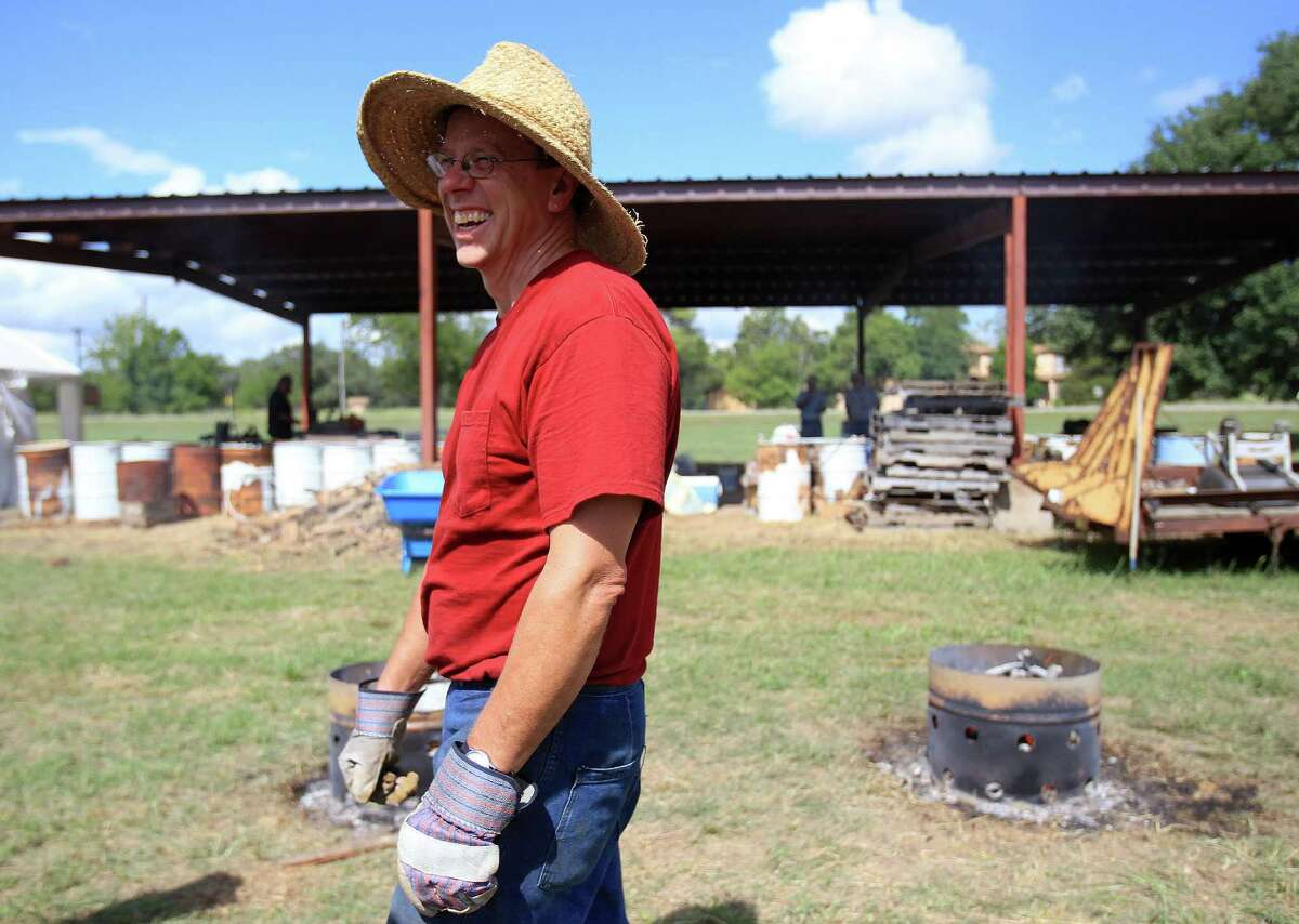 """Internationally acclaimed Virginia blacksmith/iron smelter Lee Sauder prepares to start building his """"bloom iron"""" furnace in which he will produce iron as ancient people did, in Oldenburg, which is near La Grange, Wednesday,Oct. 2, 2013, in Oldenburg."""