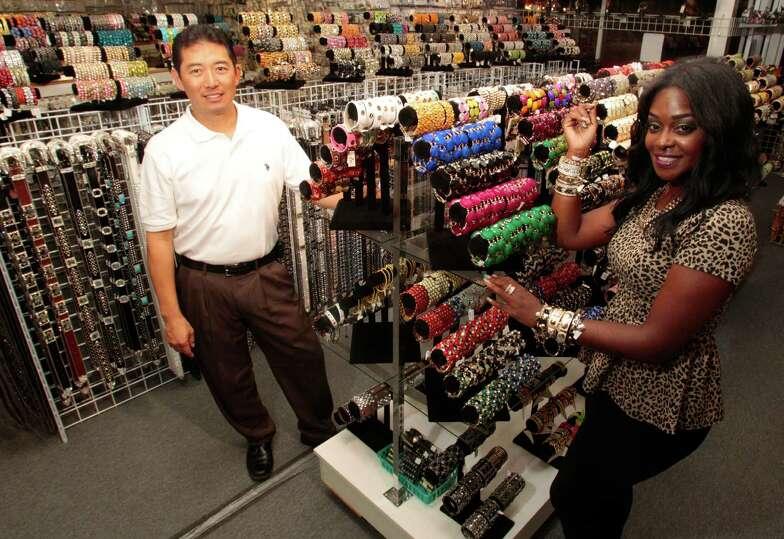 Harwin drive shops seek stronger brand identity houston for Wedding dresses on harwin in houston texas