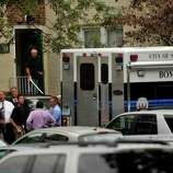 Law enforcement officials and the City of Stmford Bomb Squad descend Woodside Green Condominiums on Summer Street in Stamford, Conn. as part of the investigation into the shooting in Washington, DC earlier today, Thursday, Oct. 3, 2013.