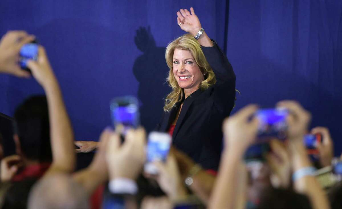 Senator Wendy Davis takes the stage to announce her candidacy for Texas Governor at W.G. Thomas Coliseum in Haltom City, TX, Oct. 3, 2013.
