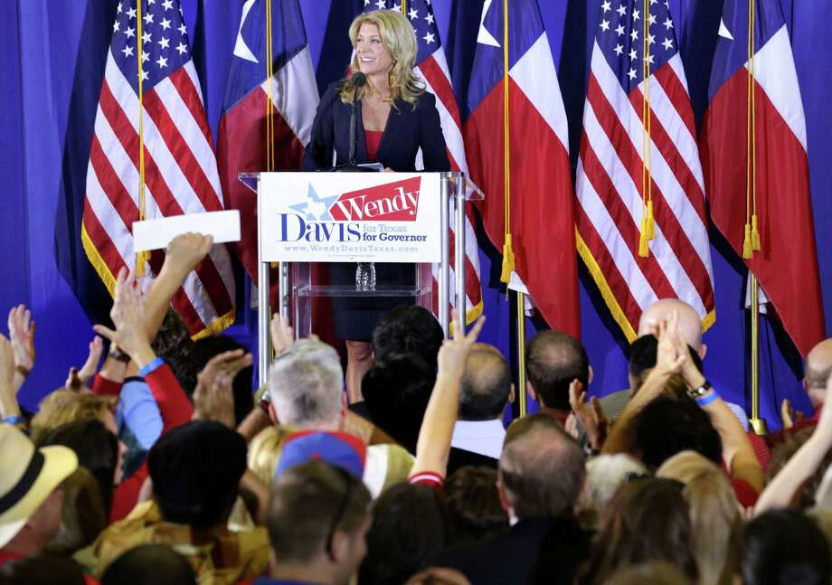 Her supporters cheer as Senator Wendy Davis announces her candidacy for Texas Governor at W.G. Thomas Coliseum in Haltom City, TX, Oct. 3, 2013. Photo: Bob Owen, San Antonio Express-News / ©2013 San Antonio Express-News