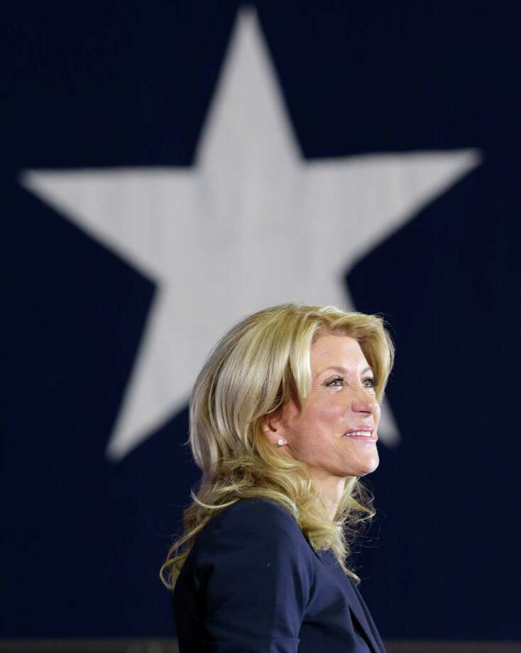 Sen. Wendy Davis, D-Fort Worth, smiles as she addresses supporters at a rally Thursday, Oct. 3, 2013, in Haltom City, Texas.  Davis formally announced her campaign to run for Texas governor (AP Photo/LM Otero) Photo: LM Otero, Associated Press / AP