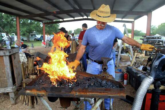 David Koenig, a retired oil company safety director, is one of a host of blacksmiths fanning the flames at this year's Forge Fest.