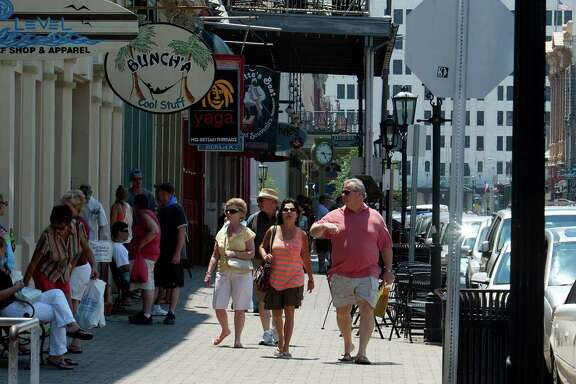 Residents and visitors walk along the historic Strand in Galveston, a shopper's paradise.