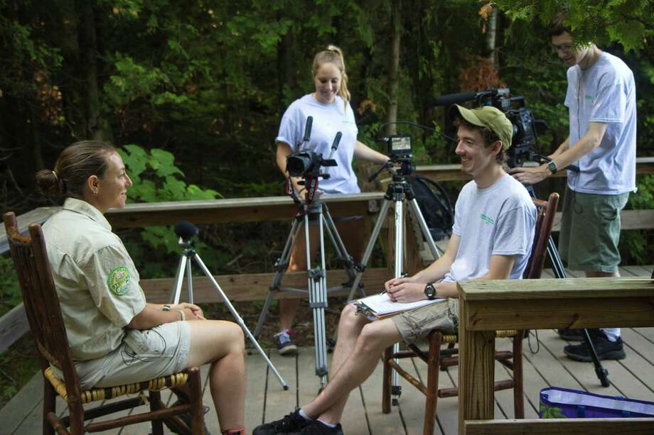 Credit: Arche Productions Director Blake Cortright [R] interviews ADK Summit Steward Julia Goren [L] near Heart Lake Photo: Arche Photography / 2012