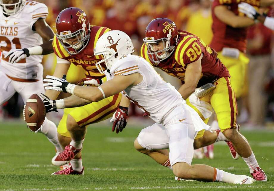 Texas wide receiver Jaxon Shipley, center, recovers a fumbled punt in front of Iowa State's Wes Boyer, left, and Justin Coleman, right, during the first half of an NCAA college football game, Thursday, Oct. 3, 2013, in Ames, Iowa. Photo: Charlie Neibergall, Associated Press / AP