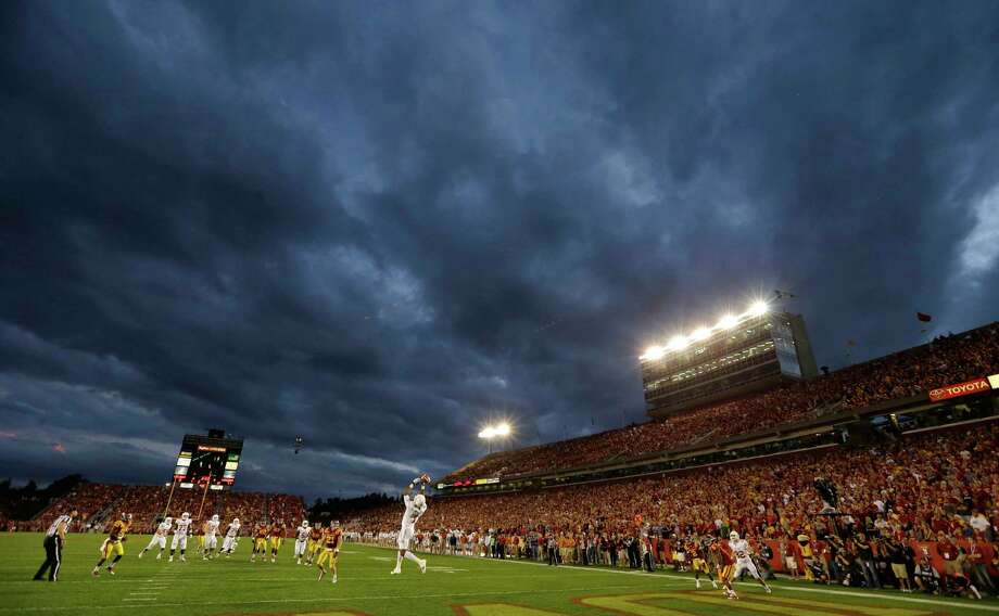 Texas wide receiver Mike Davis, center, drops a pass in the end zone during the first half of an NCAA college football game against Iowa State, Thursday, Oct. 3, 2013, in Ames, Iowa. Photo: Charlie Neibergall, Associated Press / AP