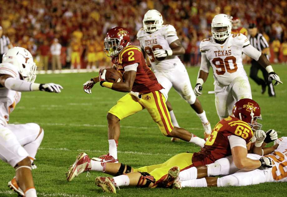 Iowa State's Aaron Wimberly (2) runs to the end zone past Texas defenders during an 11-yard touchdown reception in the first half of an NCAA college football game, Thursday, Oct. 3, 2013, in Ames, Iowa. Photo: Charlie Neibergall, Associated Press / AP