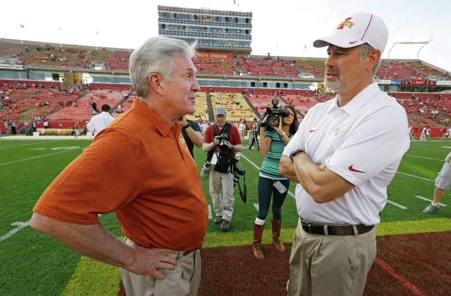 Texas head coach Mack Brown, left, talks with Iowa State head coach Paul Rhoads before an NCAA college football game, Thursday, Oct. 3, 2013, in Ames, Iowa. Photo: Charlie Neibergall, Associated Press / AP