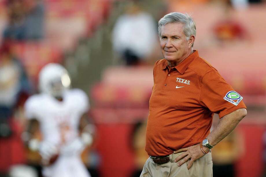 Texas head coach Mack Brown watches his team warm up before an NCAA college football game against Iowa State, Thursday, Oct. 3, 2013, in Ames, Iowa. Photo: Charlie Neibergall, Associated Press / AP