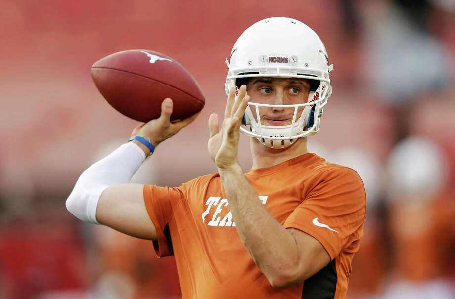 Texas quarterback Case McCoy warms up before an NCAA college football game against Iowa State, Thursday, Oct. 3, 2013, in Ames, Iowa. Photo: Charlie Neibergall, Associated Press / AP