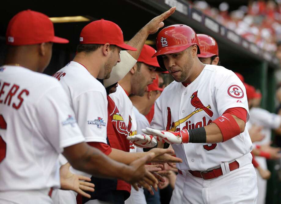 St. Louis Cardinals' Carlos Beltran, right, is congratulated in the dugout by teammates after hitting a three-run home run against the Pittsburgh Pirates in the third inning of Game 1 of baseball's National League division series on Thursday, Oct. 3, 2013, in St. Louis. (AP Photo/Jeff Roberson) ORG XMIT: MOMH125 Photo: Jeff Roberson / AP