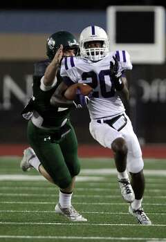 Dayton's Jacarius Keener right, breaks away from Kingwood's Michael Andrews during the first quarter of high school football game action at Humble ISD's Turner Stadium Thursday, Oct. 3, 2013, in Humble. Photo: James Nielsen, Houston Chronicle / © 2013  Houston Chronicle