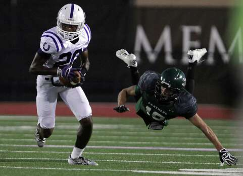 Dayton's Jacarius Keener left, breaks away from Kingwood's Mason Harris during the first quarter of high school football game action at Humble ISD's Turner Stadium Thursday, Oct. 3, 2013, in Humble. Photo: James Nielsen, Houston Chronicle / © 2013  Houston Chronicle