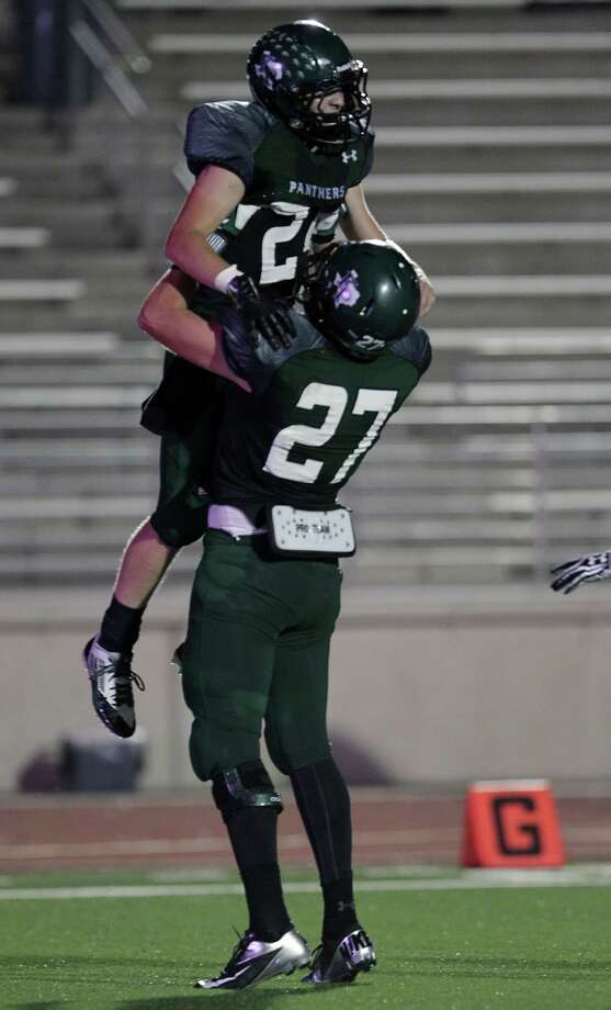 Kingwood's Garrett Velko left, celebrates with teammate Jordan Feuerbacher after Velko scored a touchdown off an interception during the second quarter of high school football game action against Dayton at Humble ISD's Turner Stadium Thursday, Oct. 3, 2013, in Humble. Photo: James Nielsen, Houston Chronicle / © 2013  Houston Chronicle