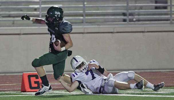 Kingwood's Garrett Velko left, breaks away from Dayton Triston Baughman right, to score a touchdown off an interception during the second quarter of high school football game action at Humble ISD's Turner Stadium Thursday, Oct. 3, 2013, in Humble. Photo: James Nielsen, Houston Chronicle / © 2013  Houston Chronicle