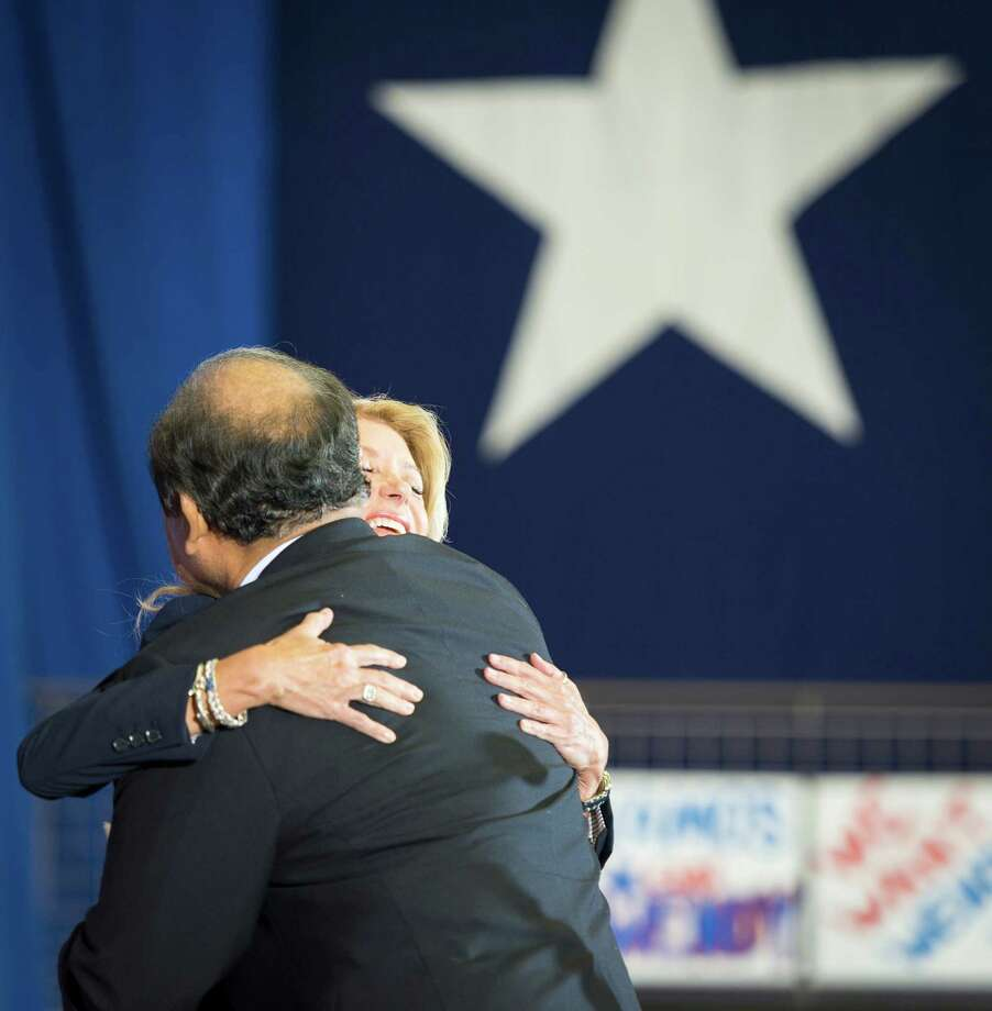Former TXU executive Alex Jimenez embraces Wendy Davis after introducing her to the crowd as she announces her candidacy for Texas governor at Wiley G. Thomas Coliseum in Haltom City on Thursday, October 3, 2013. Photo: Smiley N. Pool, Houston Chronicle / © 2013  Houston Chronicle