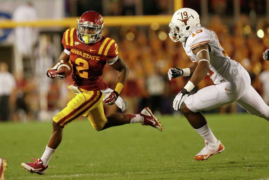 Running back Aaron Wimberly #2 of the Iowa State Cyclones rushes for yards against linebacker Peter Jinkens #19 of the Texas Longhorns in the first half of play at Jack Trice Stadium on October 3, 2013 in Ames, Iowa. Photo: David Purdy, Getty Images / 2013 Getty Images