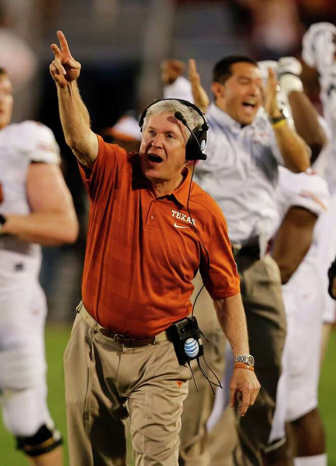 Head coach Mack Brown of the Texas Longhorns celebrates after a touchdown in the first half of play against the Iowa State Cyclones at Jack Trice Stadium on October 3, 2013 in Ames, Iowa. Photo: David Purdy, Getty Images / 2013 Getty Images