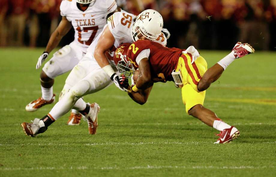 Linebacker Dalton Santos #55 of the Texas Longhorns tackles running back Aaron Wimberly #2 of the Iowa State Cyclones in the first half of play at Jack Trice Stadium on October 3, 2013 in Ames, Iowa. Photo: David Purdy, Getty Images / 2013 Getty Images