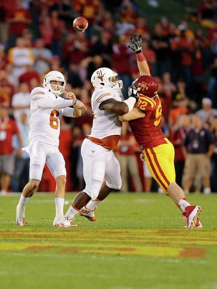 Quarterback Case McCoy #6 of the Texas Longhorns throws under pressure from defensive lineman Austin Krick #92 of the Iowa State Cyclones as offensive tackle Donald Hawkins #51 of the Longhorns blocks in the first half of play at Jack Trice Stadium on October 3, 2013 in Ames, Iowa. Photo: David Purdy, Getty Images / 2013 Getty Images