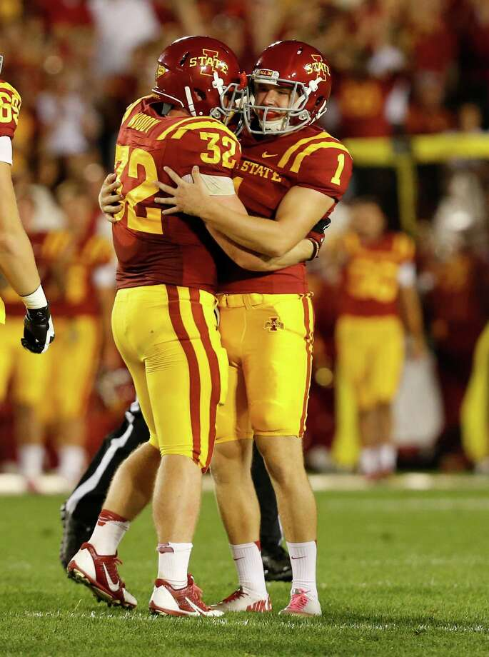 Kicker Cole Netten #1 of the Iowa State Cyclones celebrates with teammate linebacker Justin Madison #32 after kicking a field goal in the first half of play against the Texas Longhorns at Jack Trice Stadium on October 3, 2013 in Ames, Iowa. Photo: David Purdy, Getty Images / 2013 Getty Images