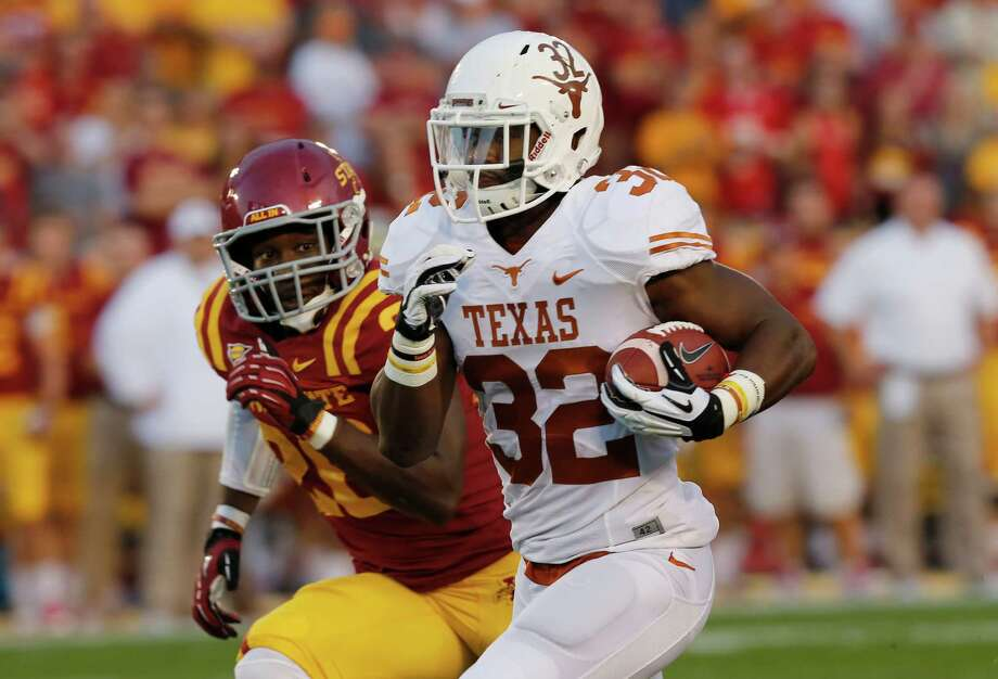 Running back Johnathan Gray #32 of the Texas Longhorns drives the ball to the end zone for a touchdown as defensive back Deon Broomfield #26 of the Iowa State Cyclones pursues in the first half of play at Jack Trice Stadium on October 3, 2013 in Ames, Iowa. Photo: David Purdy, Getty Images / 2013 Getty Images