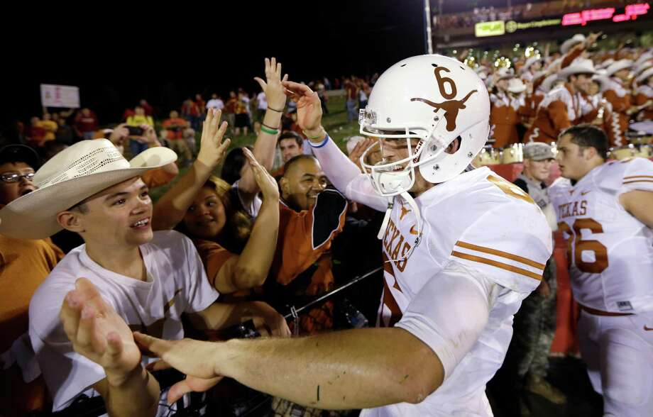 Texas quarterback Case McCoy (6) celebrates with fans after his team's 31-30 victory over Iowa State in an NCAA college football game, Thursday, Oct. 3, 2013, in Ames, Iowa. Photo: Charlie Neibergall, Associated Press / AP