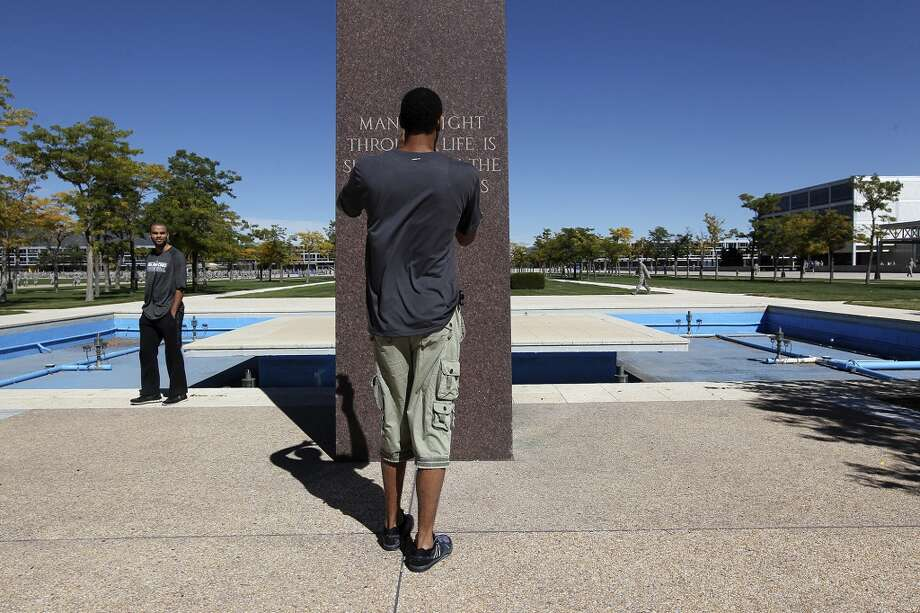 San Antonio Spurs' Tony Parker, left, and Tim Duncan check out a monument at the United States Air Force Academy, Thursday, Oct. 3, 2013. They were waiting for cadets to line up for the Noon Meal Formation. The Spurs ate lunch with cadet at Mitchell Hall at the academy in Colorado Springs, Colorado. Photo: San Antonio Express-News