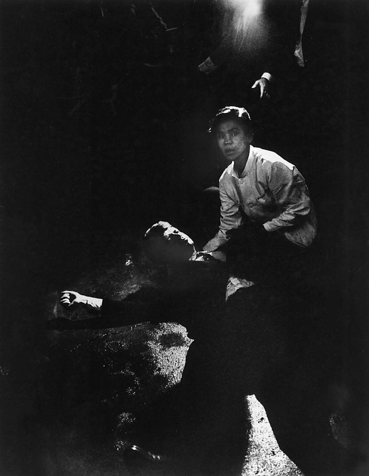 CALIFORNIA, UNITED STATES - JUNE 05: Senator Robert Kennedy sprawled semiconscious in his own blood on floor after being shot in the brain & neck while busboy Juan Romero tries to comfort him, in kitchen at hotel. NOTE: PRINT DAMAGED IN CIRCULATION PRIOR TO 2/10/1998. (Photo by Bill Eppridge/Time & Life Pictures/Getty Images)
