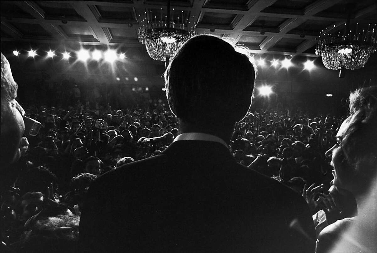 Rear view of American politician (and presidential hopeful), Senator Robert Kennedy (1925 - 1965) and wife Ethel stand at the the Ambassador Hotel podium and addresses his constituents and the press after his California primary election victory, Los Angeles, California, June 5, 1968. Shortly after leaving the podium, he was shot and died the following day. (Photo by Bill Eppridge /Time & Life Pictures/Getty Images)
