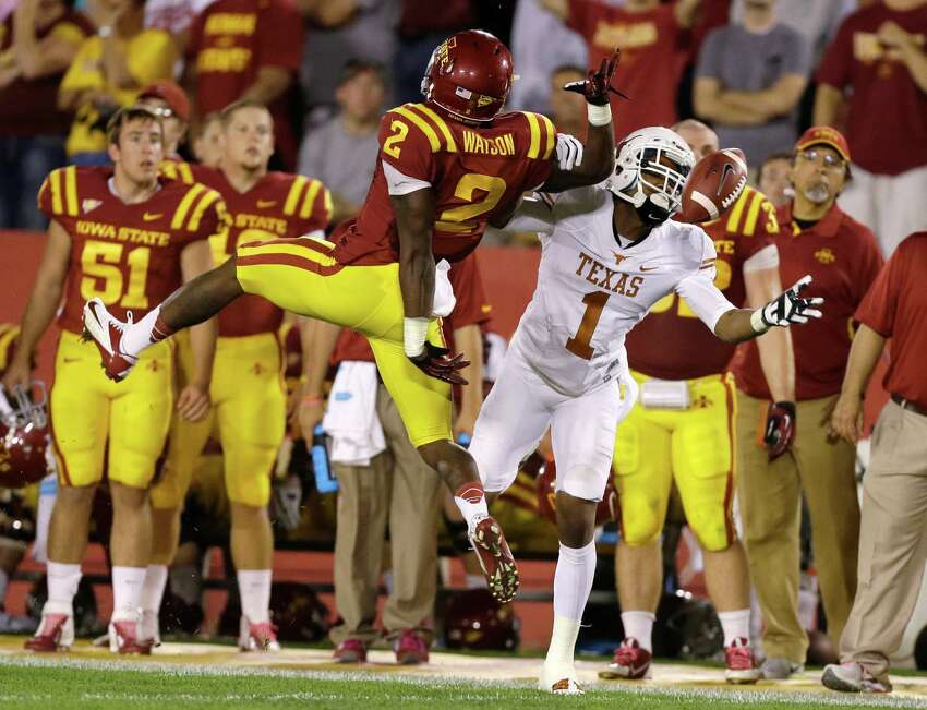Iowa State's Jansen Watson, left, breaks up a pass intended for Texas wide receiver Mike Davis (1) during the second half of an NCAA college football game, Thursday, Oct. 3, 2013, in Ames, Iowa. Watson was called for a penalty on the play. Texas won 31-30.