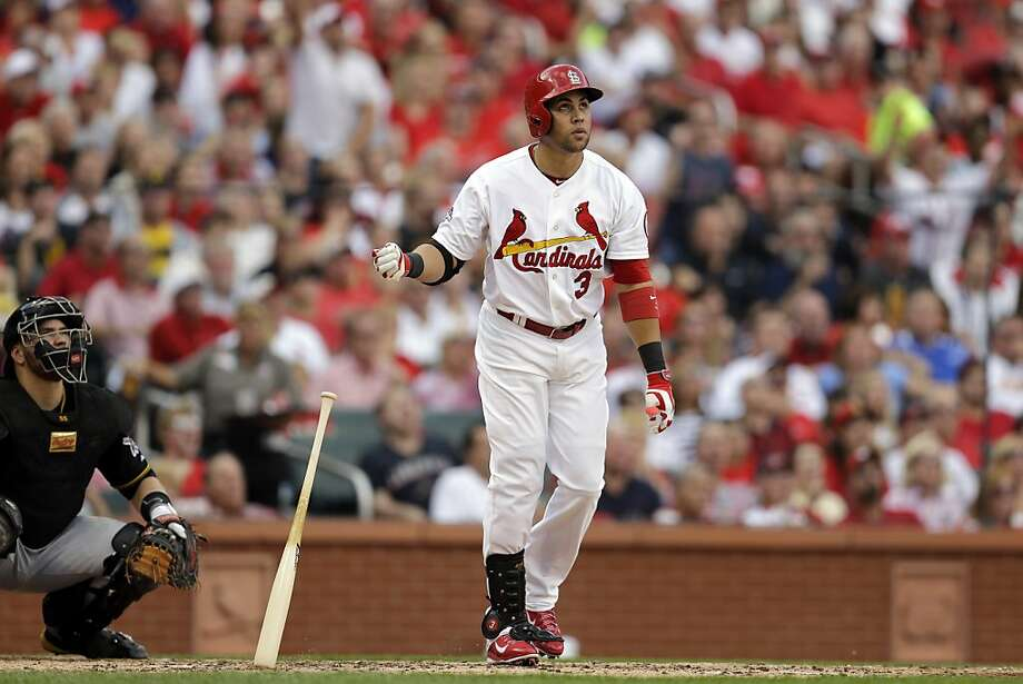 Cardinals right fielder Carlos Beltran watches the flight of his three-run homer in the third inning of Game 1 in St. Louis. Photo: Jeff Roberson, Associated Press