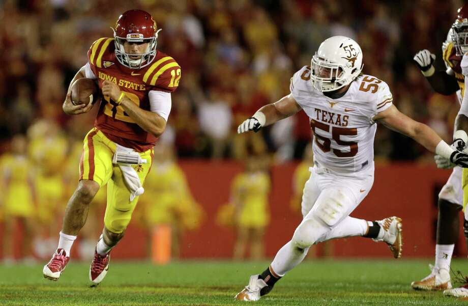 Iowa State quarterback Sam B. Richardson, left, runs from Texas linebacker Dalton Santos during the first half of an NCAA college football game, Thursday, Oct. 3, 2013, in Ames, Iowa. Texas won 31-30. Photo: Charlie Neibergall, Associated Press / AP