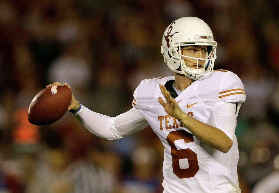 Texas quarterback Case McCoy throws a pass during the first half of an NCAA college football game against Iowa State, Thursday, Oct. 3, 2013, in Ames, Iowa. Texas won 31-30. Photo: Charlie Neibergall, A / AP