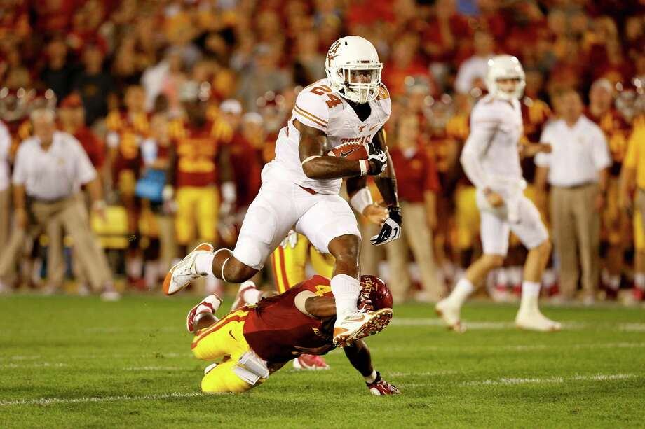 Running back Joe Bergeron #24 of the Texas Longhorns runs over defensive back Sam E. Richardson #4 of the Iowa State Cyclones while rushing for yards in the second half of play at Jack Trice Stadium on October 3, 2013 in Ames, Iowa. Texas defeated Iowa State 31-30. Photo: David Purdy, Getty Images / 2013 Getty Images