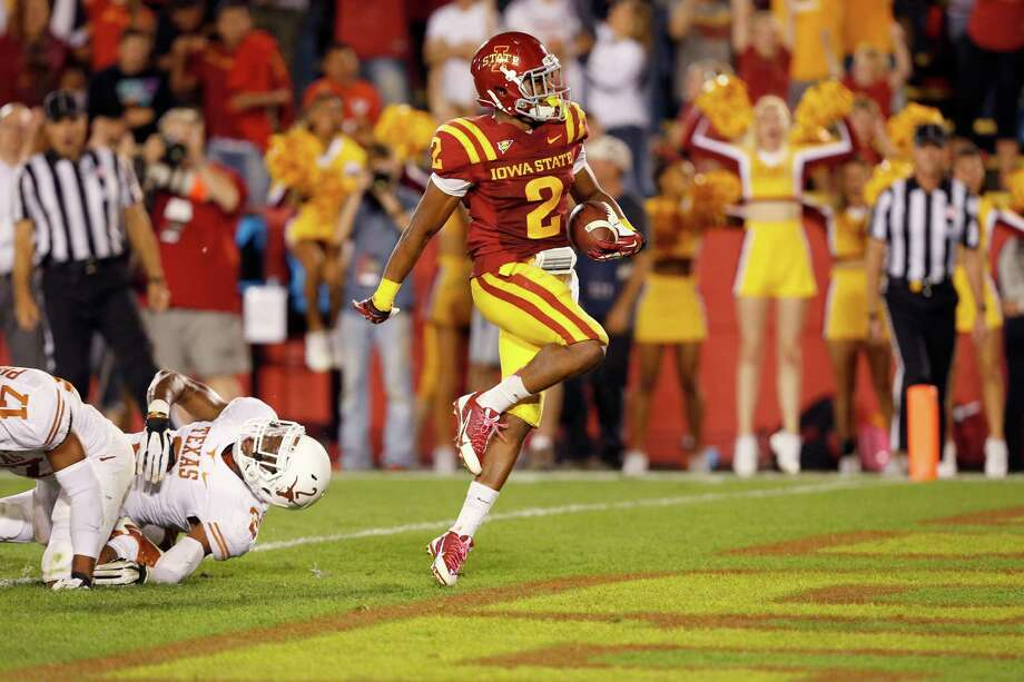 Running back Aaron Wimberly #2 of the Iowa State Cyclones runs past safety Mykkele Thompson #2 of the Texas Longhorns to score a touchdown in the second half of play at Jack Trice Stadium on October 3, 2013 in Ames, Iowa. Texas defeated Iowa State 31-30. Photo: David Purdy, Getty Images / 2013 Getty Images