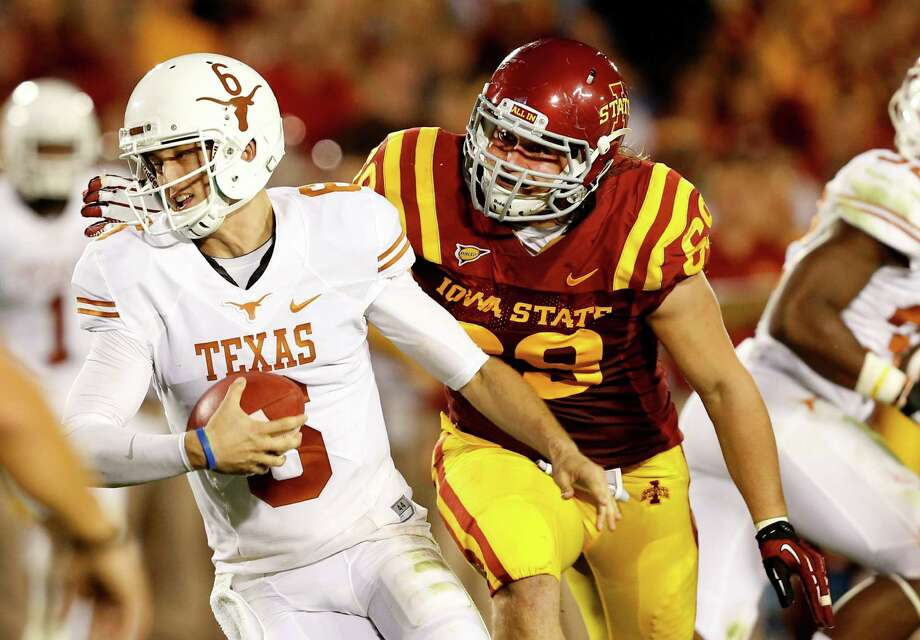 Defensive end Nick Kron #69 of the Iowa State Cyclones puts pressure on quarterback Case McCoy #6 of the Texas Longhorns in the second half of play at Jack Trice Stadium on October 3, 2013 in Ames, Iowa. Texas defeated Iowa State 31-30. Photo: David Purdy, Getty Images / 2013 Getty Images