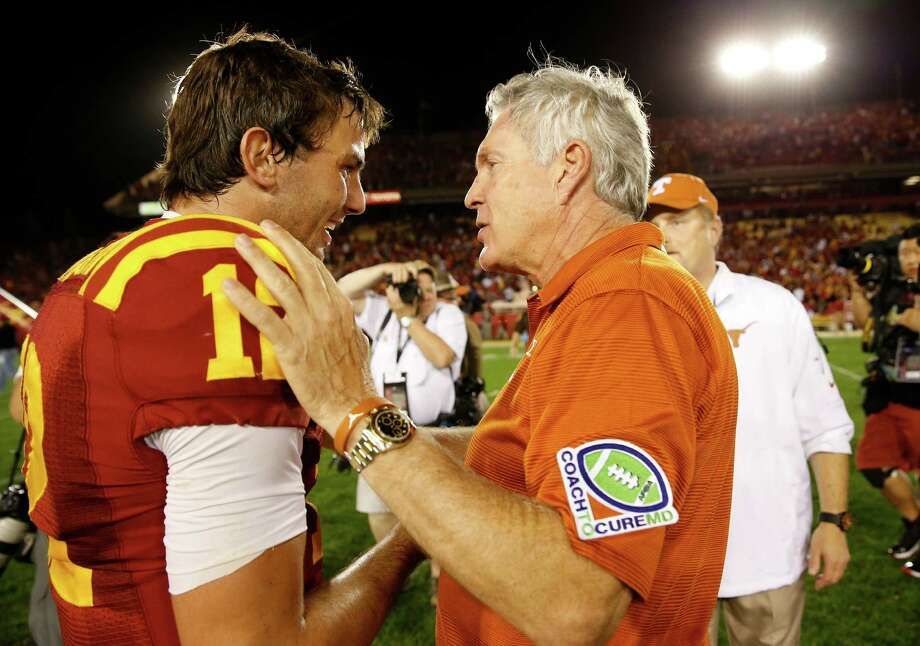 Head coach Mack Brown of the Texas Longhorns shakes hands with quarterback Sam B. Richardson #12 of the Iowa State Cyclones after the Longhorns defeated thew Cyclones 31-30 at Jack Trice Stadium on October 3, 2013 in Ames, Iowa. Texas defeated Iowa State 31-30. Photo: David Purdy, Getty Images / 2013 Getty Images