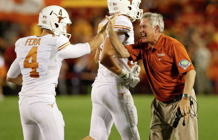 Head coach Mack Brown of the Texas Longhorns celebrates with kicker Anthony Fera #4 after an extra point in the second half of play against the Iowa State Cyclones at Jack Trice Stadium on October 3, 2013 in Ames, Iowa. Texas defeated Iowa State 31-30. Photo: David Purdy, Getty Images / 2013 Getty Images