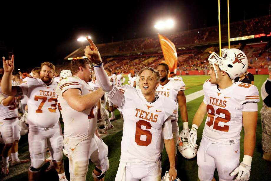 Quarterback Case McCoy #6 of the Texas Longhorns celebrates with his teammates after defeating the Iowa State Cyclones 31-30 at Jack Trice Stadium on October 3, 2013 in Ames, Iowa. Texas defeated Iowa State 31-30. Photo: David Purdy, Getty Images / 2013 Getty Images