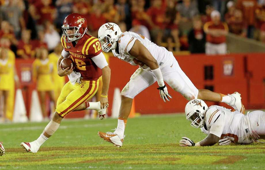 Quarterback Sam B. Richardson #12 of the Iowa State Cyclones scrambles for yards past defensive end Jackson Jeffcoat #44 of the Texas Longhorns in the second half of play at Jack Trice Stadium on October 3, 2013 in Ames, Iowa. Texas defeated Iowa State 31-30. Photo: David Purdy, Getty Images / 2013 Getty Images