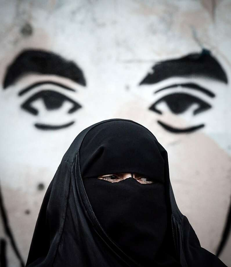 "Eyes of insurrection?A Bahraini woman demonstrates in solidarity with jailed political activists at an anti-regime rally in the village of al-Malkiya, Yemen. Last week a Bahraini court sentenced 37 Shiites up to 15 years each in prison for carrying out ""terrorist crimes"" in the kingdom. Photo: Mohammed Al-Shaikh, AFP/Getty Images"