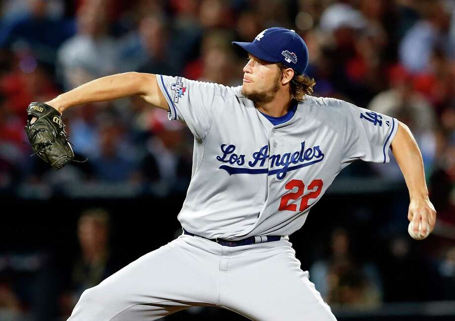 Clayton Kershaw fanned 12, the most for a Dodgers pitcher in the postseason since Sandy Koufax struck out 15 Yankees in Game 1 of the 1963 World Series. Photo: Kevin C. Cox, Staff / 2013 Getty Images